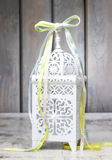 Oriental lantern on wooden table Stock Photos