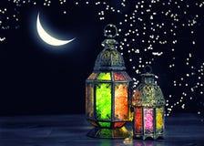 Oriental light lantern moon stars Ramadan kareem vintage. Oriental light lantern with moon and stars. Ramadan kareem. Vintage style toned picture Royalty Free Stock Image