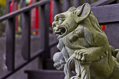 Oriental lion gargoyle 2. A lion gargoyle in art style of the orient as seen by the big dragon-like mouth and ears. Locateated in a national park in Puerto Rico Royalty Free Stock Photo