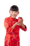 Oriental little girl holding a drink Royalty Free Stock Photos