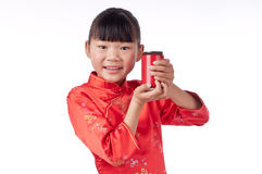 Oriental little girl holding a drink Stock Photo