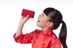 Oriental little girl holding a drink Stock Image