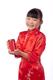 Oriental little girl holding a drink Stock Images