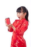 Oriental little girl holding a drink Royalty Free Stock Photo