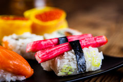 Oriental magic theme with Japanese seafood, sushi set Royalty Free Stock Photo