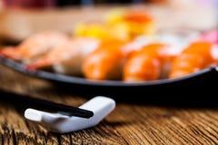 Oriental magic theme with Japanese seafood, sushi set Royalty Free Stock Image