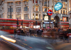 Oriental male tourist taking smartphone photo at Oxford Circus, Royalty Free Stock Image
