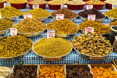 Oriental market stall with nuts and dried fruit. Stock Image