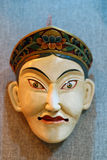 Oriental mask. In ancient oriental ritual, mask play an important role. mask have been given a mysterious religious and folk meaning. the mask is a symbol of the Stock Photo