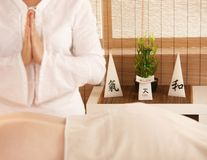 Oriental massage in day spa. Oriental decoration in day spa, candles and lucky bamboo Stock Image