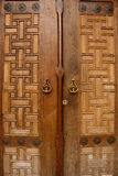 Oriental massive wooden monastery door. Oriental ornament solid wooden door Stock Photos