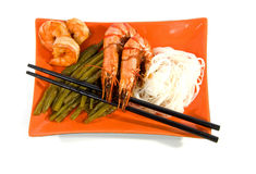 Oriental meal on orange plate Royalty Free Stock Photo