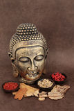Oriental Medicine. Chinese herbal medicine selection with buddha head over handmade lokta paper background stock photos