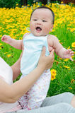 Oriental mother and her Child playing in garden Stock Photos