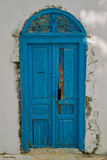 Oriental old blue door. Old door oriental Tunisian painted turquoise blue and traditional look, decorated with a semicircular lintel, decorated with a metal Stock Photo