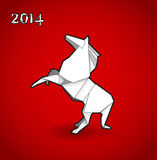 Oriental origami New year horse. On red background Stock Photo