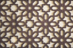 Oriental ornament. Wooden oriental ornament in front of wall Royalty Free Stock Photo
