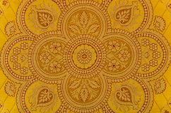 Oriental ornamented textile. Yellow oriental ornamented textile closeup Stock Photography