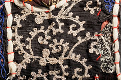 Oriental patchwork craftsmanship with wicker patterns on vintage material Stock Image