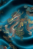 Oriental pattern on silk fabric. Oriental pattern of a dragon on silk fabric Stock Photography