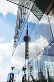 Oriental Pearl TV Tower reflection on modern glass building Royalty Free Stock Photography