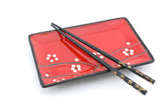 Oriental plate and chopsticks Royalty Free Stock Image