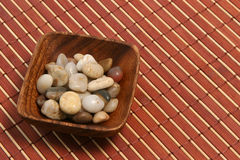 Oriental plate and stones 02. Small oriental wood plate with stones Royalty Free Stock Image