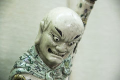 Oriental porcelain figure looking down Stock Images