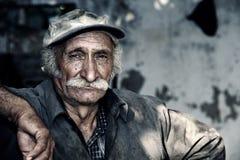Oriental portait of a farmer / worker in location Stock Photos