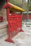 Oriental prayer. This is a red wood where buddhist write their prayer for their parents and relative. This is outside temple in China and Japan Royalty Free Stock Photo