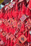 Oriental prayer. This is a red wood where buddhist write their prayer for their parents and relative. This is outside temple in China and Japan Royalty Free Stock Photos