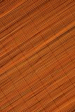 Oriental rattan mat texture. Of sunny orange color stock photo