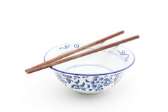 Oriental round bowl with chopsticks. Isloated on white royalty free stock image