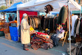 Oriental rugs and clothing sellers wait for the customers on the market Stock Image