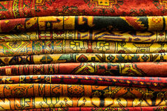 Oriental rugs. Pile of oriental rugs for sale in Isfahan, Iran Stock Image