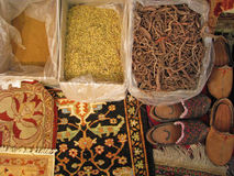 Oriental rugs - traditional making of. Ingridients for rugs making. natural colorants, part of persian bukhara rug and old traditional shoes.  ethnic handicraft Royalty Free Stock Photography