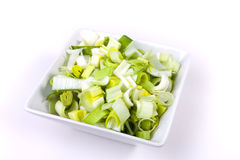 Oriental Salad. Of chopped leek and celery in attractive white bowl against white background Royalty Free Stock Photography
