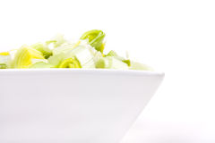 Oriental Salad. Of chopped leek and celery in attractive white bowl against white background Royalty Free Stock Images