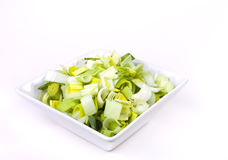 Oriental Salad. Of chopped leek and celery in attractive white bowl against white background Stock Photography
