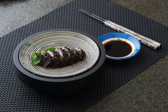 Oriental seafood. On a plate with sauce and a pair of chopsticks Stock Photography