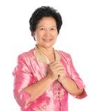 Oriental senior woman greeting Royalty Free Stock Photos