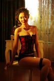Oriental sexy belle. Oriental bombshells indoor dark color photo Royalty Free Stock Images