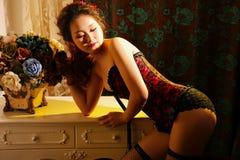 Oriental belle. Oriental bombshells indoor dark color photo stock photos