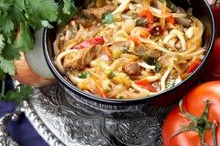 Oriental soup lagman. Uzbek thick soup lagman on oriental plate Stock Photography