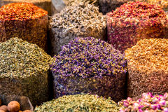 Oriental spices on display at arabic spice market. Closeup of spices at spice market in Middle East Royalty Free Stock Images