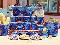 Oriental spices and souvenirs. In colorful pots Royalty Free Stock Photos