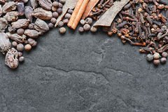 Oriental spices on the stone background Royalty Free Stock Image