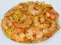 Oriental spicy dish plate with shrimps and noodles. White plate with thai shrimps and egg noodles with sugar sauce Stock Photography