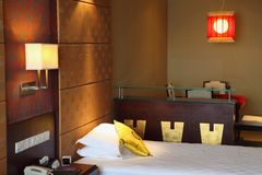 Oriental style bedroom. Oriental style resort bedroom in China Royalty Free Stock Photos