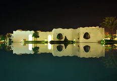 Oriental style buildings night reflection in pool stock photography